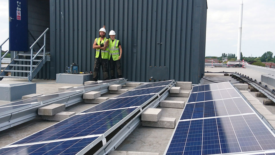 Solar Roofers relaxing after installing the apartment complex solar system
