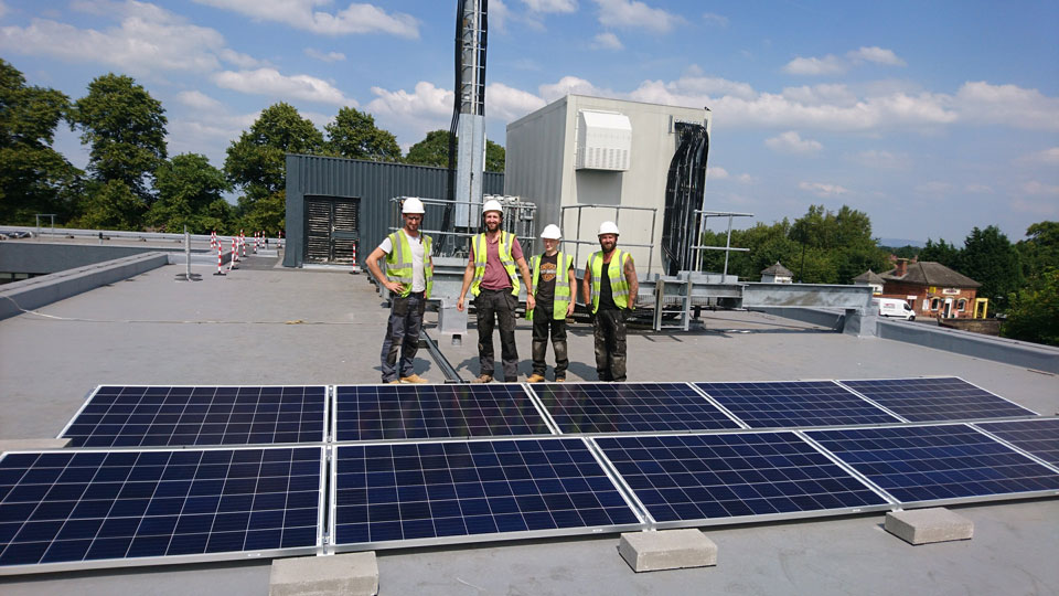 Atlantic Renewables Solar team behind the flat roof solar panel system in manchester
